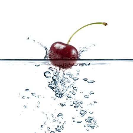 cherry splash in transparent water, on white background photo