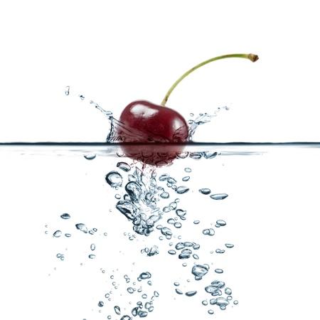 cherry splash in transparent water, on white background