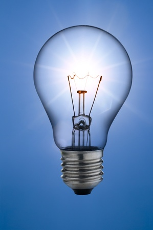 incandescent light bulb, on sunny skies background photo