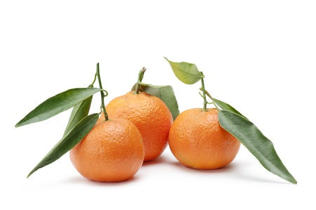 tangerines with foliage, on white background