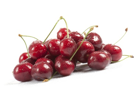 wet cherries on white background