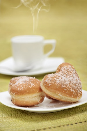breakfast with donuts and coffee, on yellow tablecloth photo