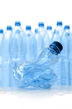 compressed: group of empty plastic bottles with crushed ones Stock Photo