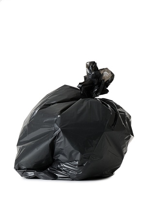 black waste bag full of garbage,isolated on white photo