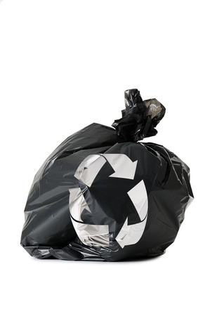 crushed aluminum cans: black waste bag with recycling symbol, isolated on white