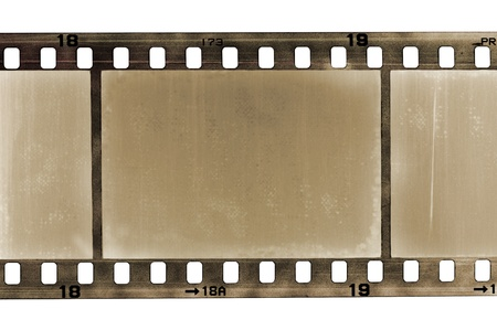 celluloid film: old scratched frame of 35mm film, isolated on white