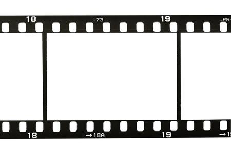 35 mm フィルムのストリップ、白で隔離されるのフレーム