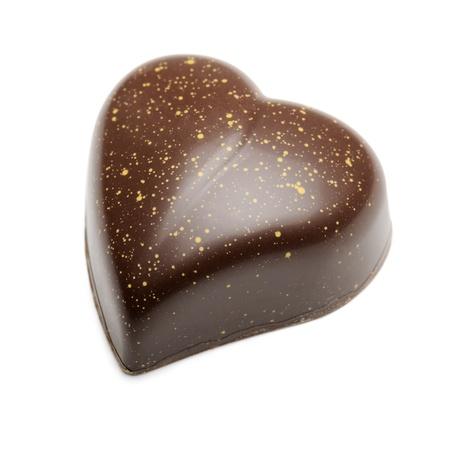 chocolates heart-shaped, isolated on white Imagens