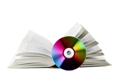 open book with near compact disk, on white background photo