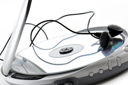 compact disk: music compact disk with earphones, on white background