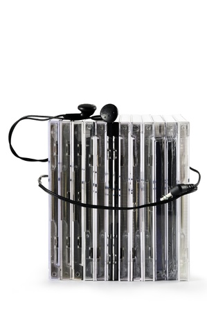 compact disk: stack of compact disk with earphones, on white background