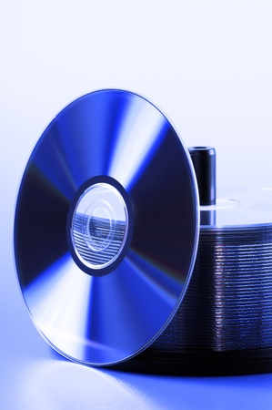 recordable media: stack of compact disk, on blue lighting