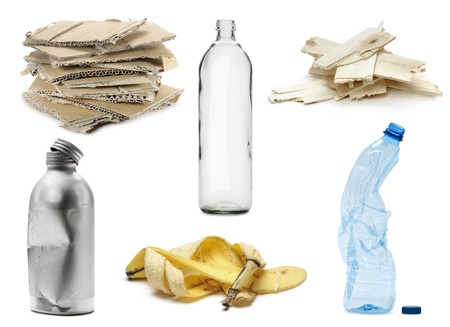 a different kinds of recyclable waste, isolated on white photo