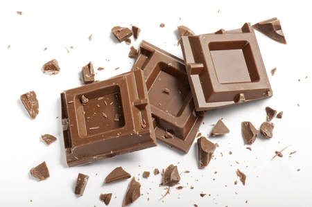 chocolate blocks with pieces, on white background