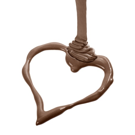 melted chocolate: melted milk chocolate heart shaped, isolated on white