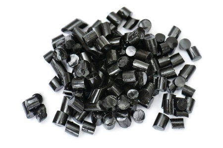 licorice: black pieces liquorice candy, on white background Stock Photo