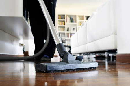 woman who cleans the floor of the house photo