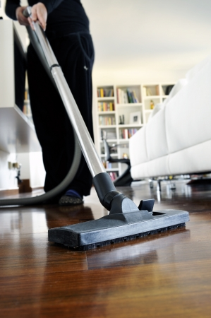 clean  electric: woman who cleans the floor of the house