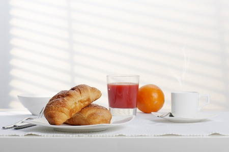 corn flakes: continental breakfast with fresh croissant, coffee and orange juice