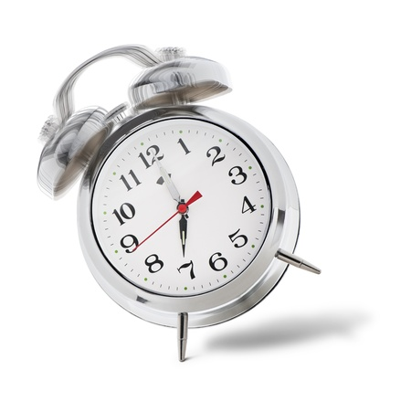 classical alarm clock ringing on white background photo
