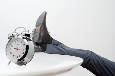 lazy: manager with feet on desk at noon Stock Photo