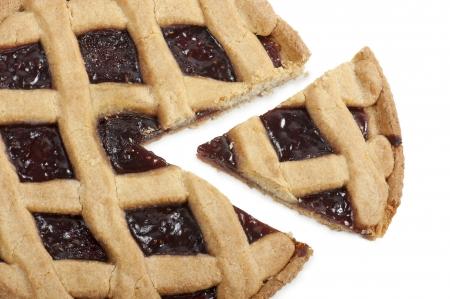 fruit tart cut with slice, on white background photo