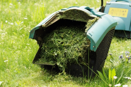 binder lawn mower full of lawn grass