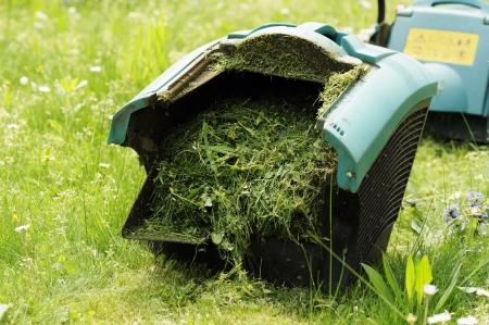 binder lawn mower full of lawn grass