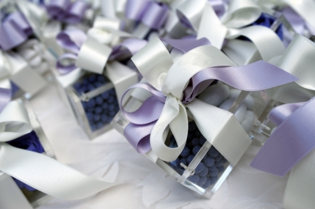 wedding table with favors and present photo