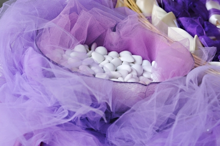 confetto: white sugared almond on pink wedding basket