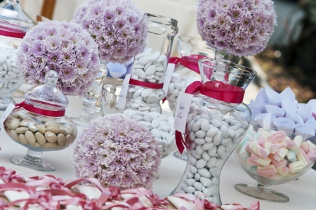 colourful candy: wedding table with confetti and candies Stock Photo