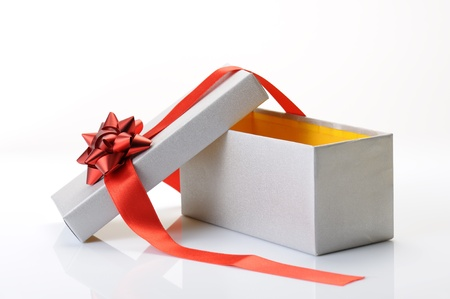 open gift box with bow and red ribbon on white background Stock Photo