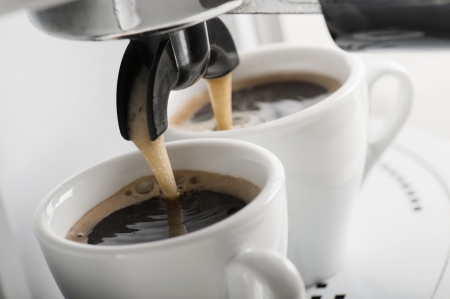 brewing: close up of coffee machine makes two coffee Stock Photo