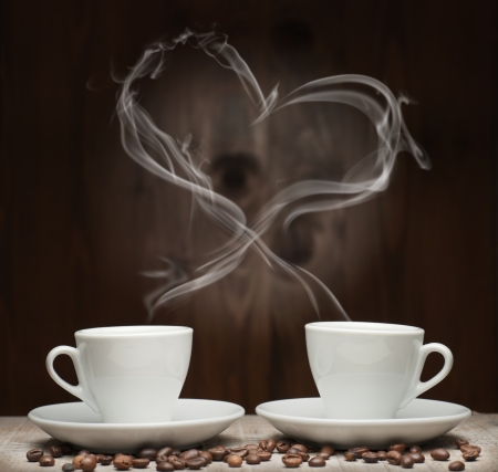 shaped: two cup of coffee with smoke shaped like a heart Stock Photo