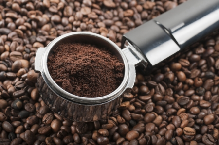 full coffee dispenser on coffee beans photo