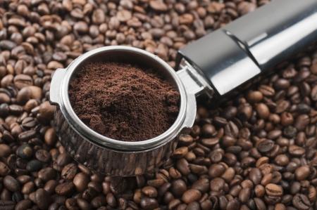 coffee crop: full coffee dispenser on coffee beans