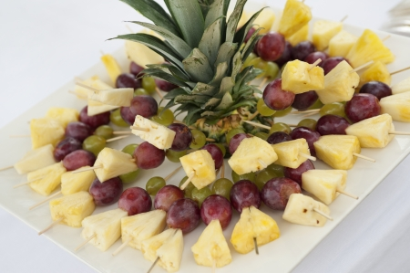 buffet table with fruit skewers