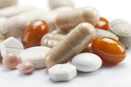 variety of colorfull pills and tablets, close up on white background Stock Photo