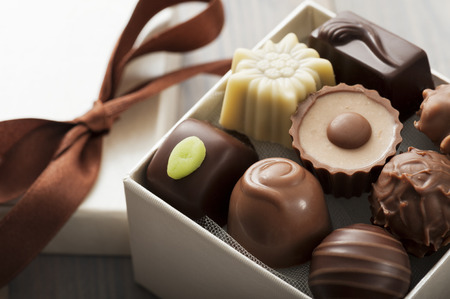 assorted chocolates confectionery in their gift box, close up photo