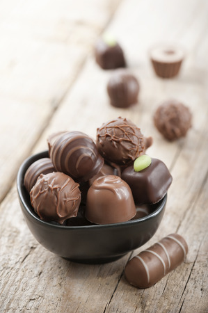 assorted chocolates confectionery in a black bowl