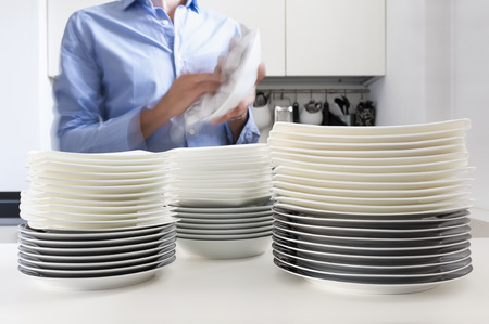 dish washing: Man in kitchen who cleans the dishes Stock Photo