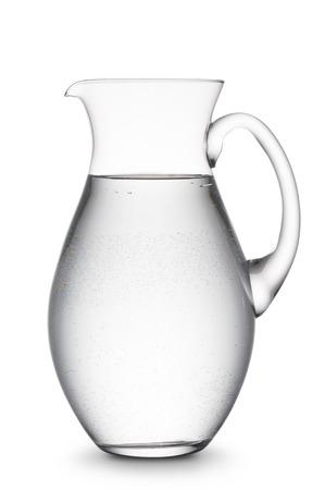 jug full of natural water, on white background Stock Photo