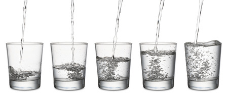 jet of water that fills a glass, set of glasses from empty to full, on white background