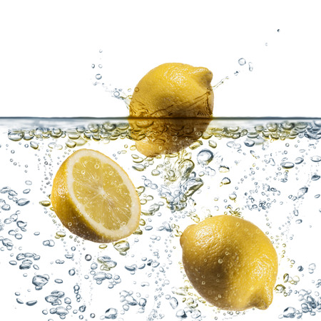 lemon splash on sparkling water, on white background