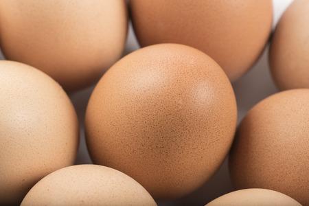 group of raw eggs on white background closeup Stock Photo