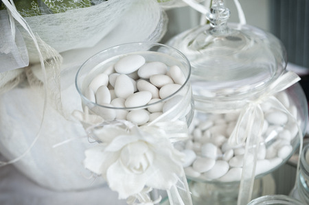 confetto: white sugared almond in glass jars Stock Photo