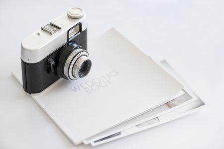 photocamera: 35mm vintage photocamera on wedding book with print