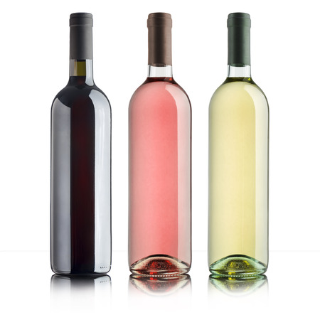 white wine: bottles with variety of wines, on white background