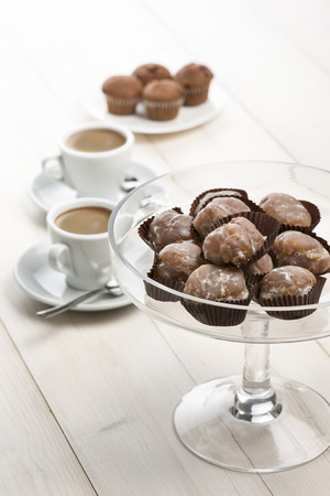marron: marron glace on glass tray on white table with cups of coffee