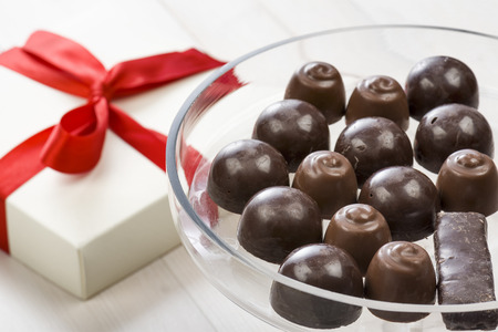 confectionery: assorted chocolates confectionery on glass tray